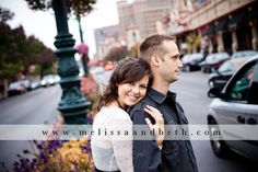 Rainy day engagement session on the Country Club Plaza ~ Kansas City Engagement Photographers Melissa & Beth
