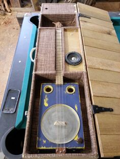 WV guitar in case with built in amp by Logan Maxwell