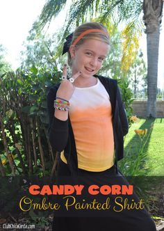 Candy Corn Ombre Spray Painted Shirt - mix fabric paint and water in an empty spray bottle to create this cool ombre effect