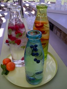 We might fill old-fashioned glass milk-bottles/jars with tea and lemonade and such at the reception! :)