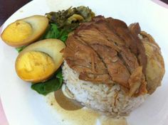 Braised pork leg with rice and side veggie and boiled egg.