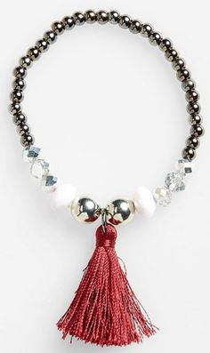 faceted bead and tassel stretch bracelet http://rstyle.me/n/v93tspdpe