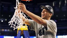 Shabazz Napier cutting down the nets after Leading Uconn over Mihigan State to the Final Four