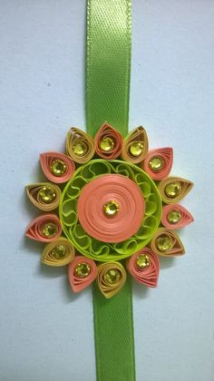 Quilling rakhi R Clothes Women, Fashion Clothes, Quilling Rakhi, Handmade Rakhi Designs, Rakhi Making, Paper Quilling Patterns, Quilling Jewelry, School Craft, Paper Flowers Diy