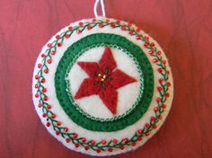 poinsettia round hand embroidered and beaded ornament