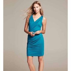 Banana Republic dress Very pretty turquoise color! It wraps across the front. It's sleeveless. The dress has a lot of stretch to it. 93% viscose and 7% elastane. New with tags. Banana Republic Dresses