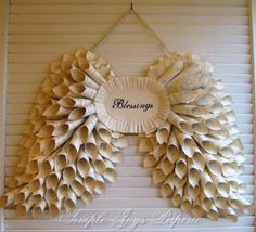 angel wings made from book pages/music sheets rolled into cones...this would be precious for a baby shower