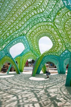Pleated Inflation is an amphitheater composed of 990 porous structural pleats.   MOCO LOCO