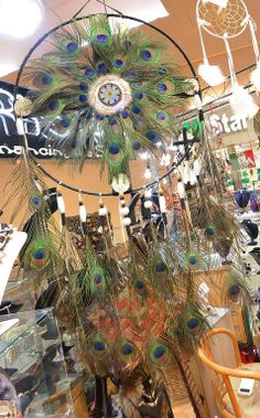 Beautiful Peacock Feather dream catcher at Romancing The Stone at Festival Flea Market Mall.
