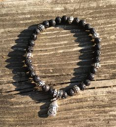 This stretch beaded Unisex Buddha tibetan silver and volcanic lava stone bracelet is perfect for any occasion and is handcrafted using genuine lava stone imported from Southeast Asia made from volcanic earth.