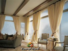 Elegant yellow gold curtain windows with enchanting arm chair & sensational gray sofa extraordinary window curtains completes the look & feel of the room.