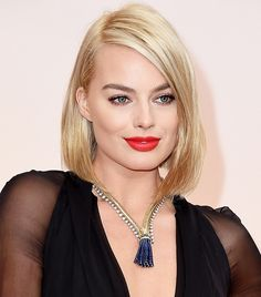 Margot Robbie balanced her simple, sleek bob with a bold red lip, messy brows, and stunning tassel necklace at the 87th Oscars