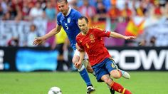 10Jun.2012 / Andrés Iniesta of Spain and Thiago Motta of Italy during their UEFA EURO 2012 Group C match