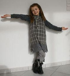 Two man's shirts and some pants that were too small were refashioned into a gorgeous tunic style dress with a matching scarf and capri pants. Stains were carefully hidden with cute heart patches. She also made a vest to match from an unwanted older siblings coat. #refashion #reinvent #Sew #RefashionforGirls