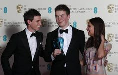 Will Poulter (C) celebrates winning the Rising Star award with Eddie Redmayne (L) and Alicia Vikander at the BAFTA awards ceremony at the Royal Opera House in London February 16, 2014. video: https://www.youtube.com/watch?v=2fbqLK8uso0
