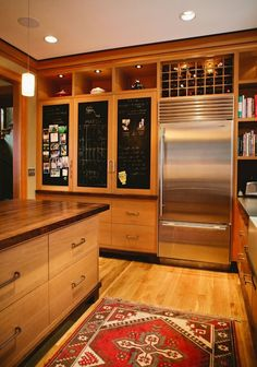 Cabinets next to refrigerator.