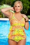 These Orange and yellow triple tiered tankini also come in a lime / aqua color, in sizes 16W to 26W. They have adjustable straps that you can also cross in the back for even more secure support. While relatively new, they have six reviews so far, all of them give this style 5 stars!