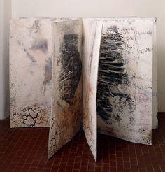 Dein und mein Alter und das Alter der Welt  2005  Sculpture with 8 pages (16 faces) of various materials  151 x 101 x 101 cm