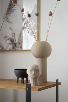 A collection of sculptural pieces, Pillar vase in Sand and Olufemi sculpture from Cooee Design in muted oatmeal tones and black stoneware Elephant pot by Massa Design on an oak and steel bookshelf, designed by ENKL. Steel Bookshelf, Bookcase Wall, Bookshelf Design, Wall Shelves, Painting Bathtub, Salvaged Doors, Interior Decorating, Interior Design, Modern Interior