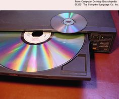"This 12"" LaserDisc platter looks like a dinosaur compared to the DVD on top of the case, but in the 1980s, LaserDiscs were very high tech."
