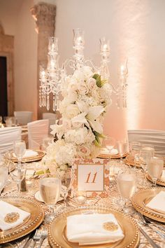 Romantic White and Gold Centerpiece Idea.  This one's a bit too rustic, but good concept.  Gold Chargers