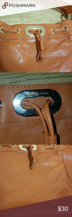 Michael Kors Leather Bag Purse Double strap MK bag. Small and very good looking purse. Four inside pockets with one being a zip closure. Good conditions. The purse has a few light scratch marks on the front. Michael Kors Bags Shoulder Bags
