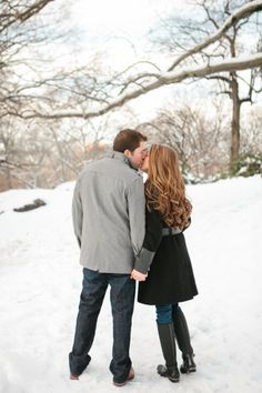 Kisses in the snow! http://www.stylemepretty.com/new-york-weddings/new-york-city/2015/02/14/central-park-ice-skating-engagement-session/ | Photography: Sweetwater - http://sweetwaterportraits.com/