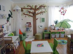 A beautiful calming, nature inspired daycare space. I would love to ditch all the plastic toys for this.