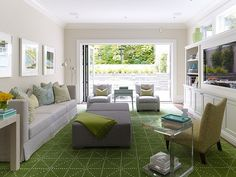 Bright living room with green rug Historic Home Renovation in Cow Hollow Stuns With Its Modern Makeover