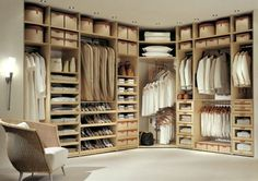 Interesting idea for utilizing the space in the corner. Or even continue the shelves down the entire length for purses. Or put a pole in the center with round shelves attached and make a shoe carousel.