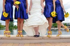 Stunning...royal blue bridesmaids with sunflower bouquets & yellow shoes!  Looks terrific!  www.joycesbridalhouse.com