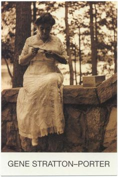 portrait of gene on stone steps of her house overlooking the lake