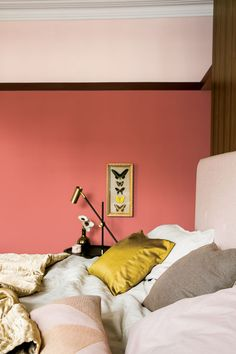 Coral pink bedroom walls, gold and pink bed linen. For more like this, click the… Dulux Paint Colours, Bedroom Wall Paint, Bedroom Paint Colors, Bedroom Decor, Pink Bedroom Decor, Bedroom Interior, Red Bedding, Pink Bedroom Walls, Bedroom Wall Colors
