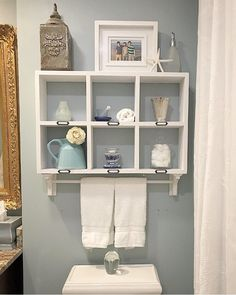 Coastal bathroom styled shelf with towel rack Towel rod