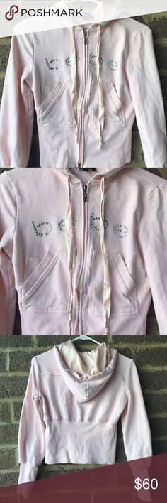 Pink Bebe zip up Beautiful light pink Bebe zip up hooded jacket.  Super soft with silky drawstrings and silky inner hood.  In perfect condition.  No flaws / damage.     ✅Offers through the offer button 🎀Ask for a custom bundle bebe Tops Sweatshirts & Hoodies