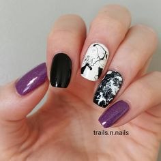 Purple, black and white marble nails