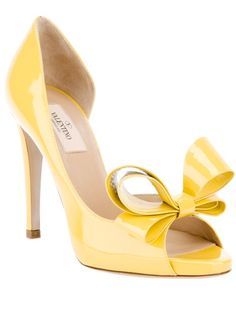 Short Bus Shoes    Yellow patent leather pump from Valentino featuring a peep toe, a leather bow detail at the toe, a cut detail to the side, a leather covered stiletto heel and a leather sole.