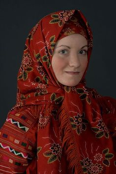 Central Asia | Portrait of a woman wearing traditional clothes and headscarf, Russia