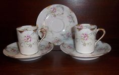 Set of 2 cups and 3 saucers with a pink rose pattern by Theodore Haviland Limoges France Ca. 1800 - 1900.