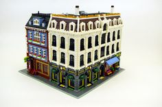 https://flic.kr/p/qHHwxC | Loft Apartments & Shops with Wine Store | My 19th custom modular Lego building; an apartment building with six lofts and three street-level shops.