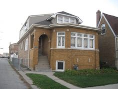 JUST LISTED by John Sommese of Carrington Real Estate Services. 5 Bedroom, 3 bath- Berwyn, ILLinois. Large brick bungalow with dormered attic. Living room offers stained glass windows, Artificial fireplace with electric heater. Formal dining room with French doors. Kitchen has maple flooring, granite counter tops, dishwasher and built-in microwave. Three 1st floor bedrooms with an updated marble tiled bath. The 2nd floor offers 2 full updated marble baths, along with 2 bedrooms.