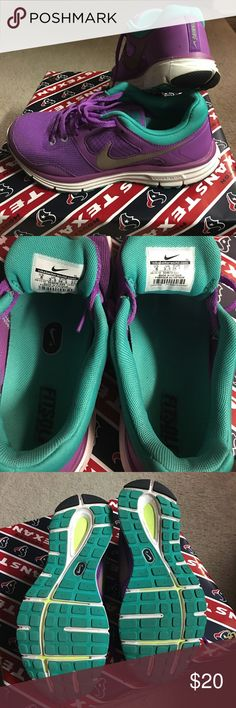 Nike running tennis shoes Purple, blue-iah-teal Nike's. Super comfy. Can't fit. Worn maybe 5x's at most. Still in perfect condition Nike Shoes Sneakers