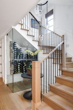 A stairway a wine cellar. quite the gorgeous duo and yet climbing this beauty has never looked less graceful after a glass or three! Builder: Patterson Custom Homes Interior: Anne Michaelsen Design Lens: Chad Mellon Photographer