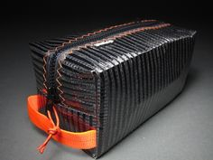 Carbon Fiber toiletry bag from RAGGEDedge Gear. Stronger then steel at a fraction of the weight.