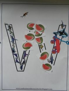 Using watermelon and whale and wagon stickers to make a W