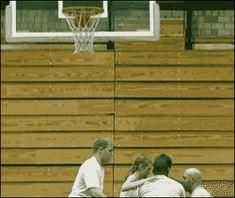 Guys flip a girl through a basketball hoop