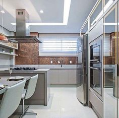 Love the bronze back splash and color and design of the kitchen Kitchen Dinning, Home Decor Kitchen, Interior Design Kitchen, Home Kitchens, Dining Room, Kitchen Breakfast Nooks, Home Lighting, Home And Living, Decoration
