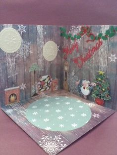 """Folding box card inside. PB hedgie,tree layered with dimensionals. Hand cut fireplace and furniture. Cuttlebug embossing folder pictures. Cheery Lynn """"Merry Christmas"""" die, IO holly die garland."""