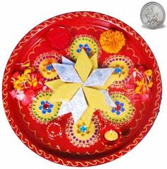 As the Festival of lights is round the corner, It's time to gift your dear ones, A beautiful  Red Round Thali decorated with stone containing  kaju katli & Kesar Kaju Katli weight 500gms.this comes with a complimentary  SILVER PLATED COIN will be deliverd with this gift.http://www.exoticabazaar.com/view/9318-68-ghasitaram-diwali-tikka-special-mix-kaju-katlis-thali.html