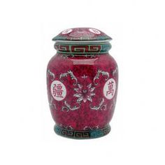 Lidded jar with a floral motif. Product: Tea jarConstruction Material: PorcelainColor: FuchsiaFeatures: Traditional designDimensions: 5.75 H x 4 Diameter